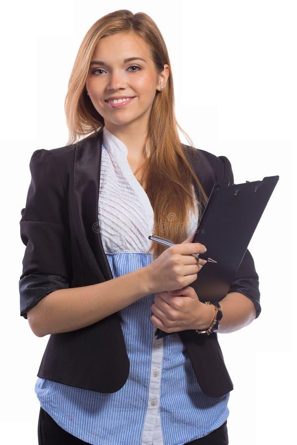 愉快的女商人画象有剪贴板的 免版税库存照片