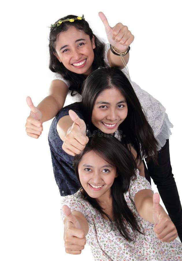3愉快的女孩赞许 库存图片