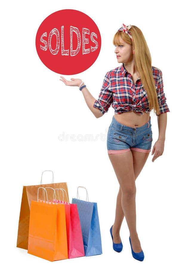愉快的女孩shopaholic与色的购物袋 库存照片