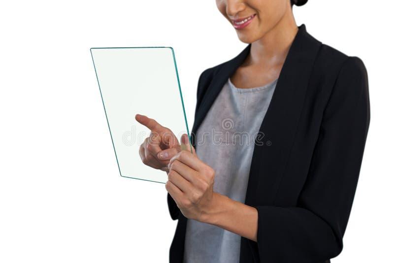 愉快的女实业家感人的玻璃接口的中间部分 库存照片