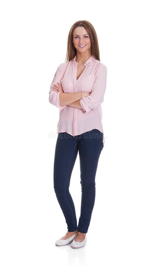 愉快的妇女常设胳膊横渡在白色背景 库存照片