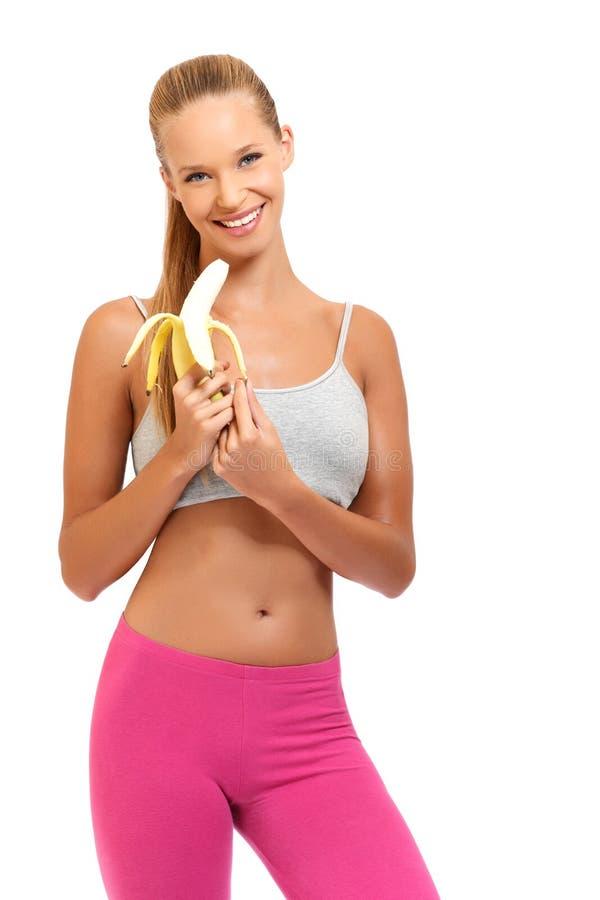 愉快的妇女用在空白背景的香蕉 库存图片