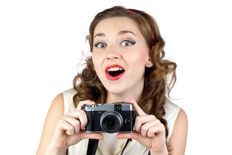 愉快的妇女的图象有减速火箭的照相机的 免版税库存图片
