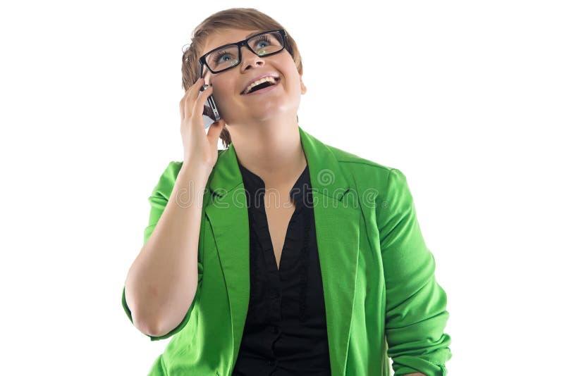 愉快的妇女的图象讲话由电话 免版税库存图片