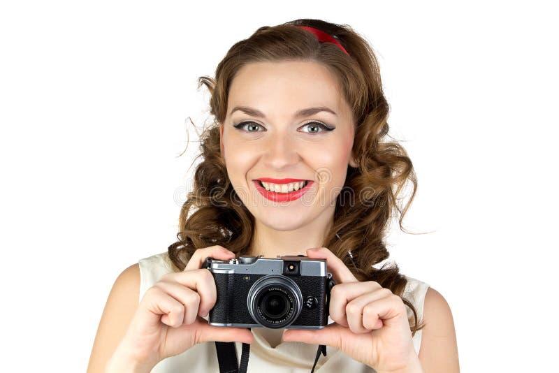 愉快的妇女的照片有减速火箭的照相机的 免版税库存照片