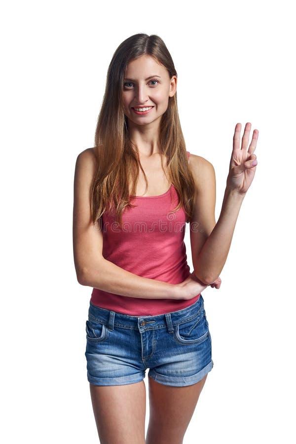 愉快的妇女简而言之显示三个手指的 库存照片