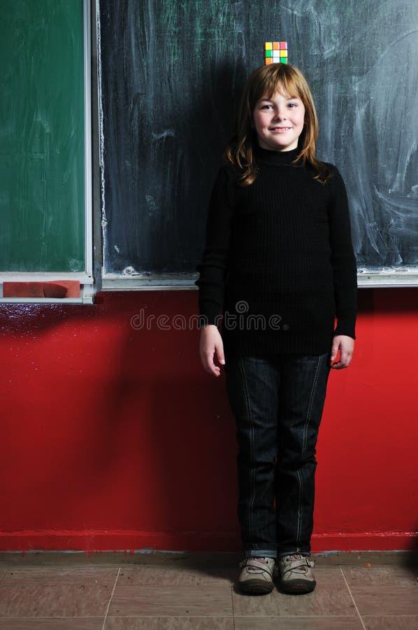 愉快的学校女孩 免版税库存图片