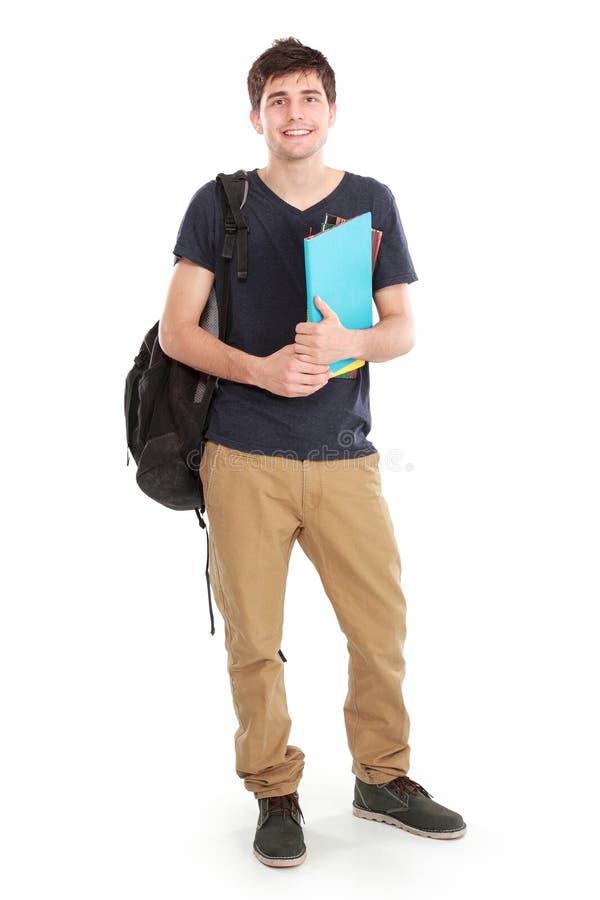 年轻愉快的学生运载的书 库存照片