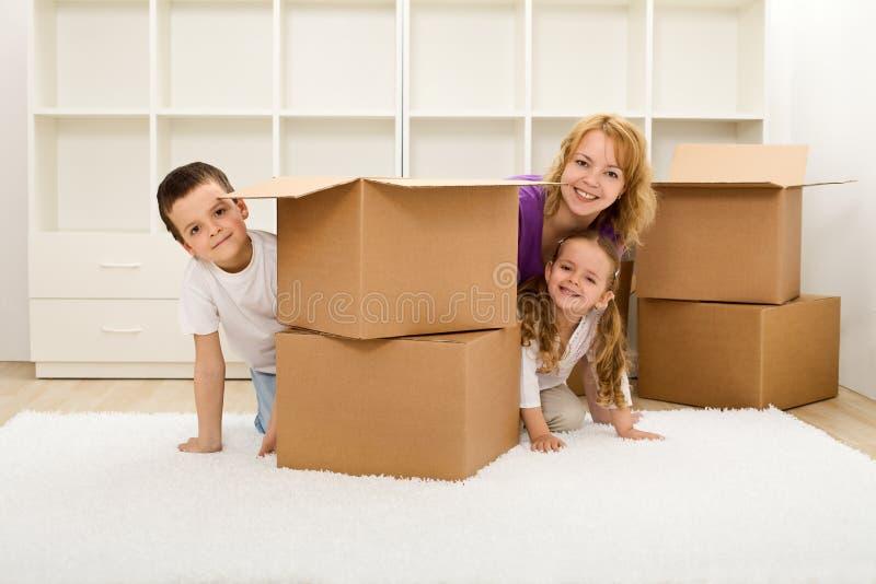 愉快的家开玩笑新的妇女 免版税库存照片