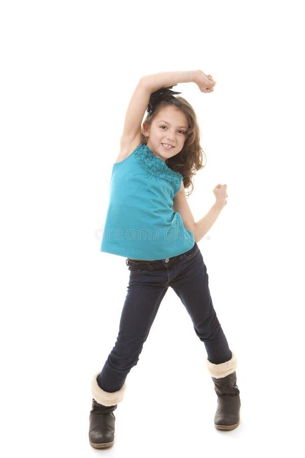 愉快的小女孩跳舞 免版税库存图片