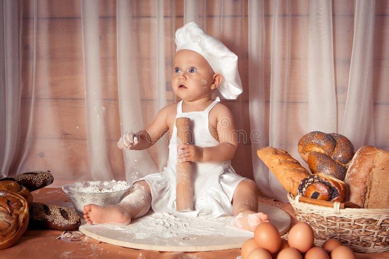 愉快的小面包师 库存图片