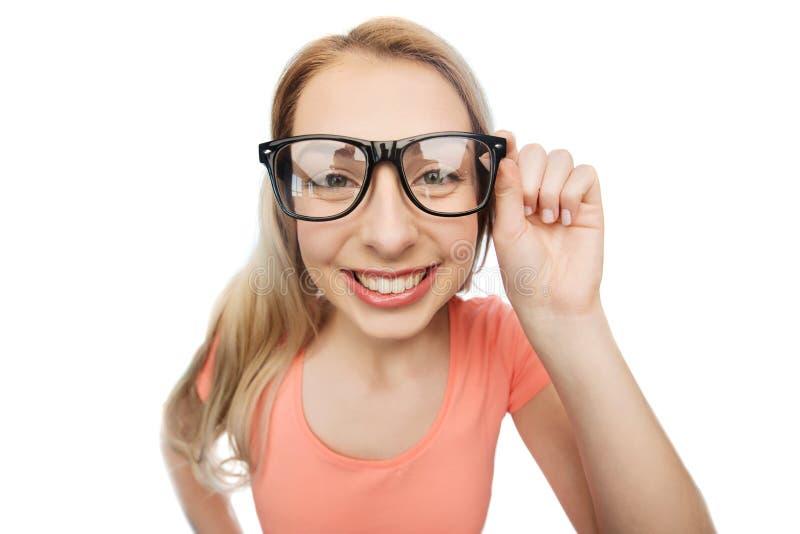 愉快的少妇或十几岁的女孩镜片的 免版税图库摄影