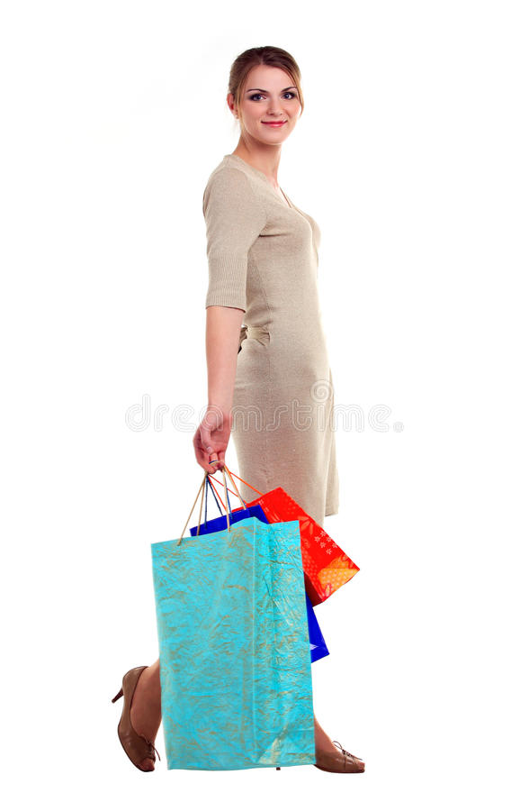愉快的少妇运载的购物袋 库存图片
