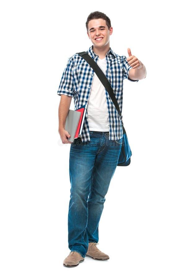 愉快的少年显示赞许 免版税图库摄影