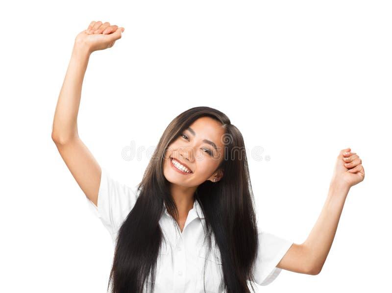 愉快的年轻东方妇女跳舞或欣喜在白色背景 库存图片