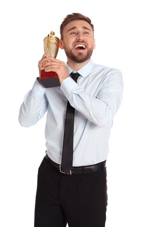 愉快的年轻商人画象与金战利品杯子的 库存照片