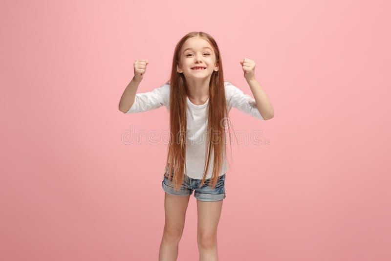 愉快的庆祝成功青少年的女孩是优胜者 女性模型的动态精力充沛的图象 免版税库存图片