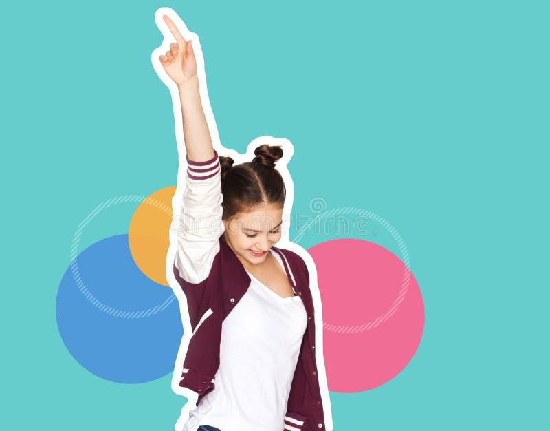 愉快的微笑的十几岁的女孩跳舞 免版税库存照片