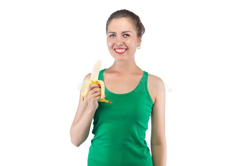 愉快的微笑的妇女的图象用香蕉 免版税库存图片