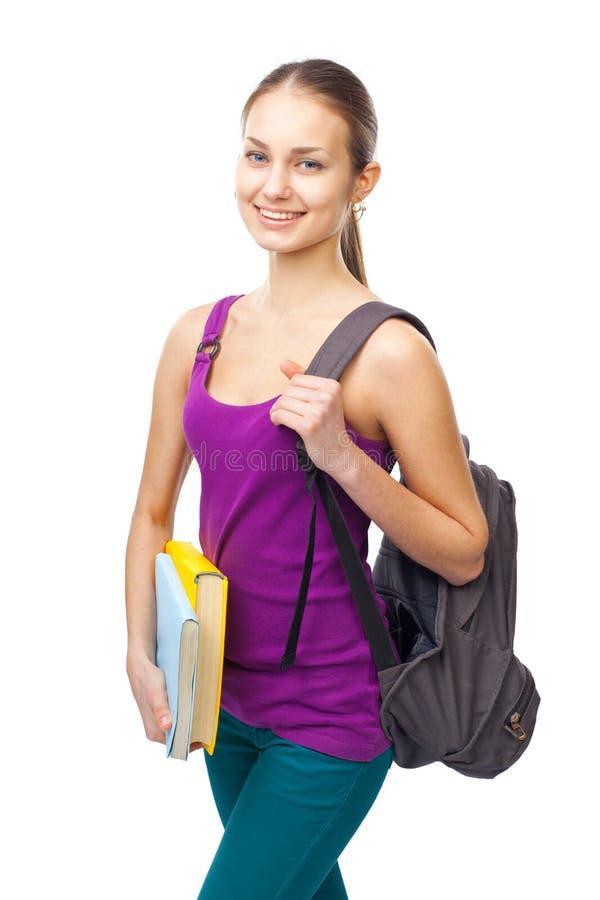 年轻愉快的微笑的学生女孩 免版税图库摄影