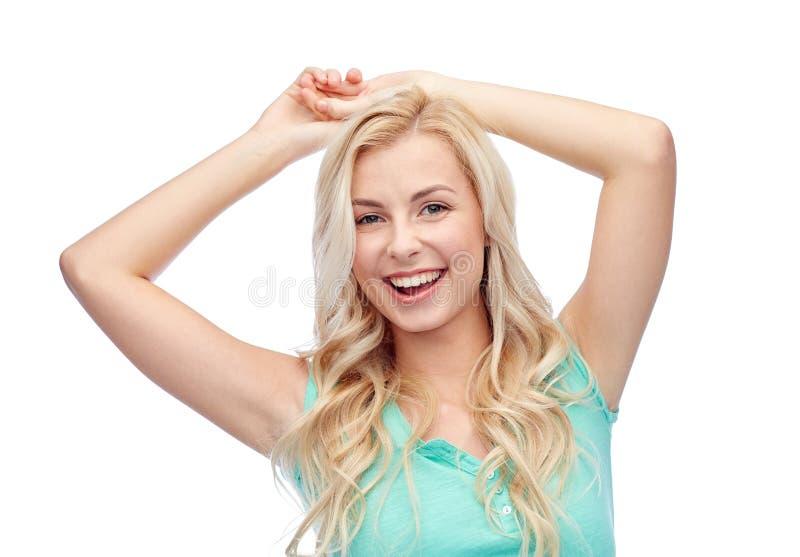 愉快的微笑的少妇或十几岁的女孩 免版税库存图片