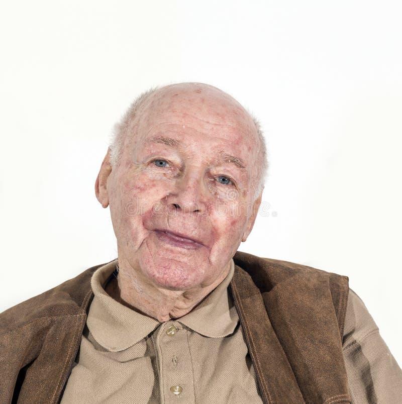 愉快的微笑的老人退休的人 免版税库存照片