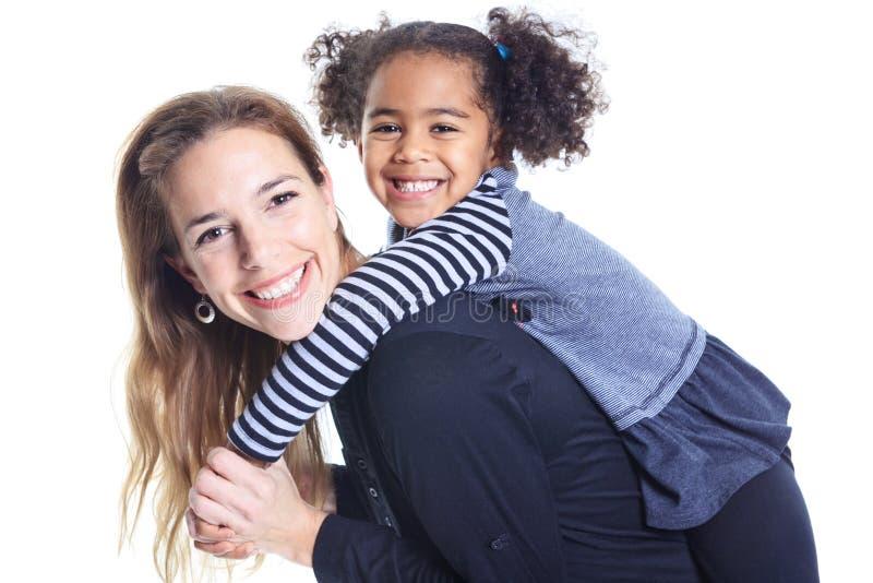 愉快的快乐的非洲家庭画象在白色ba的 免版税库存图片
