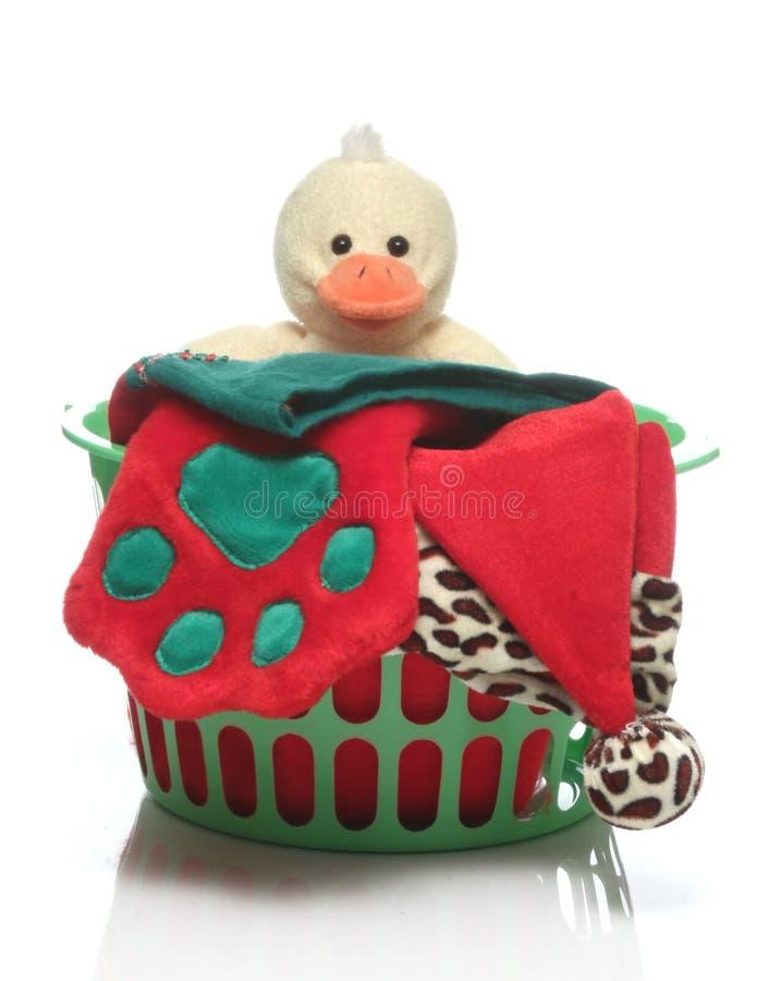 愉快的快活的X mas逗人喜爱的玩偶圣诞老人帽子和圣诞节袜子 库存照片