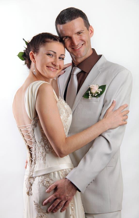 愉快的新婚佳偶纵向 图库摄影