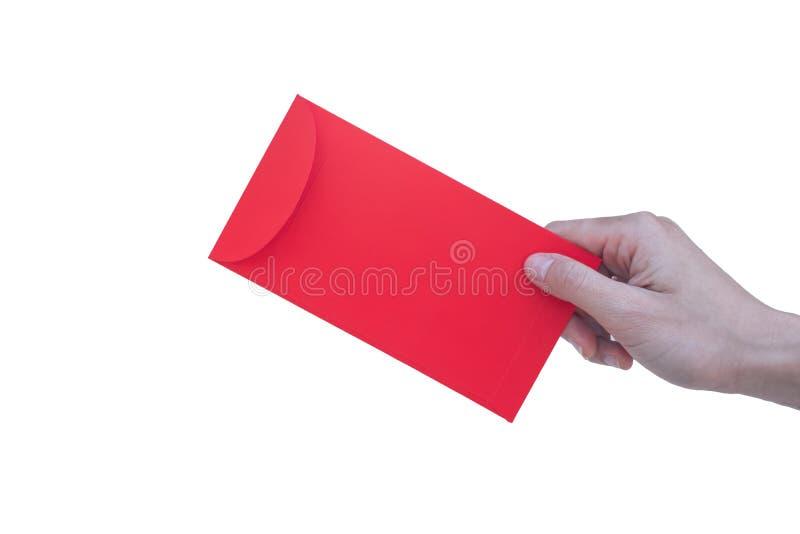 愉快的春节,拿着红色信封的手或在白色背景叫Angpao隔绝了 库存照片