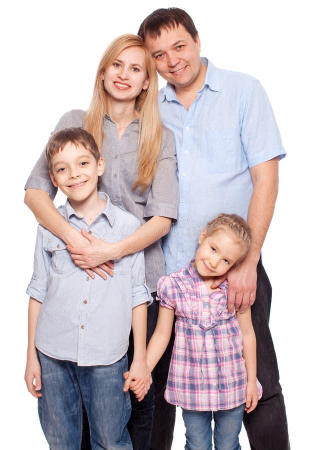 愉快的母亲、父亲、儿子和女儿 图库摄影