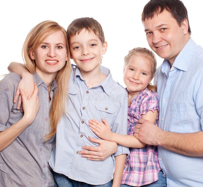 愉快的母亲、父亲、儿子和女儿 库存图片