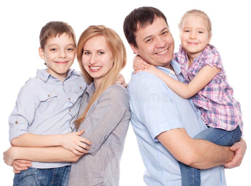 愉快的母亲、父亲、儿子和女儿 免版税库存照片
