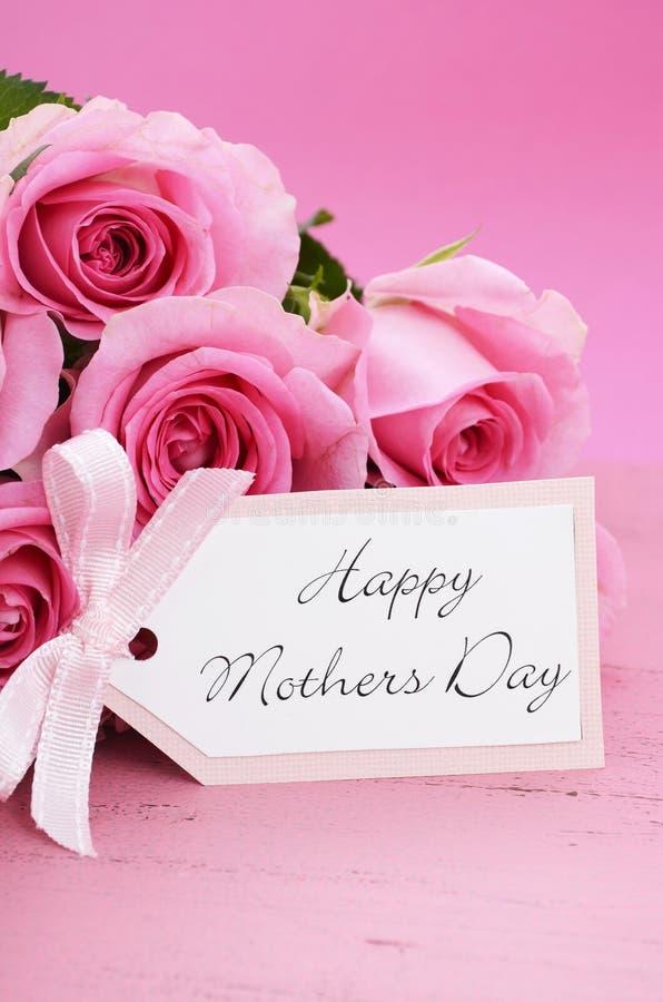 愉快的母亲节桃红色玫瑰背景 库存图片