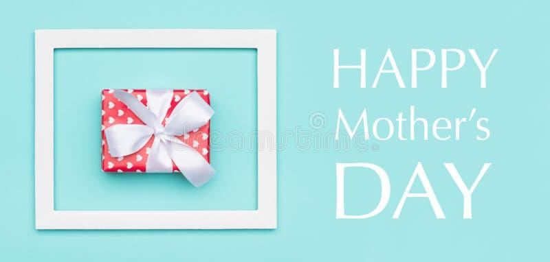 愉快的母亲` s天淡色蓝色糖果颜色背景 母亲节舱内甲板被放置的最小的网横幅 库存照片