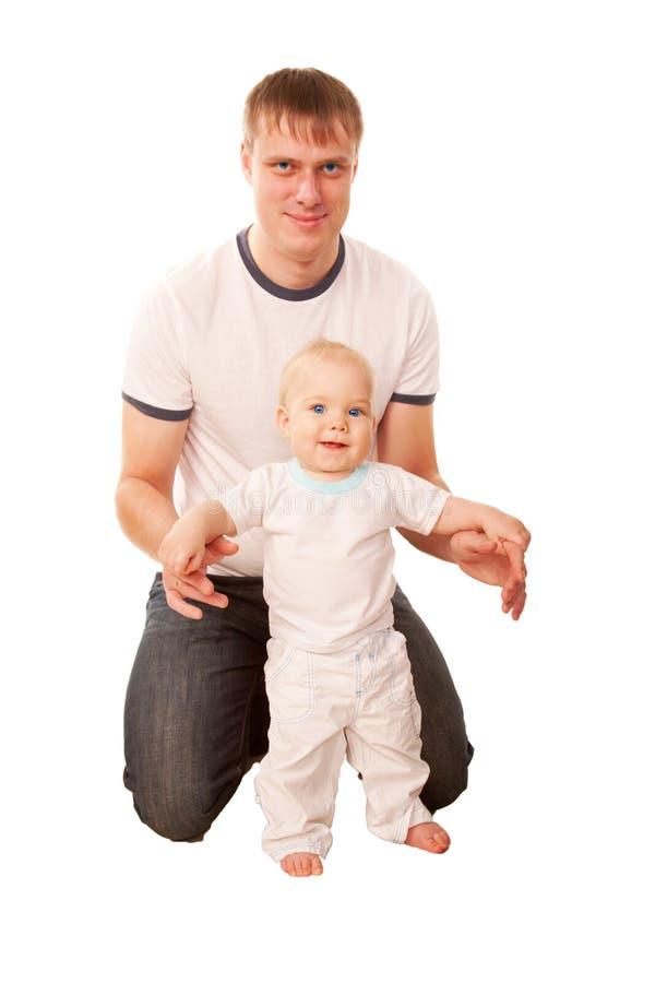 愉快的父亲和婴孩。 免版税库存图片