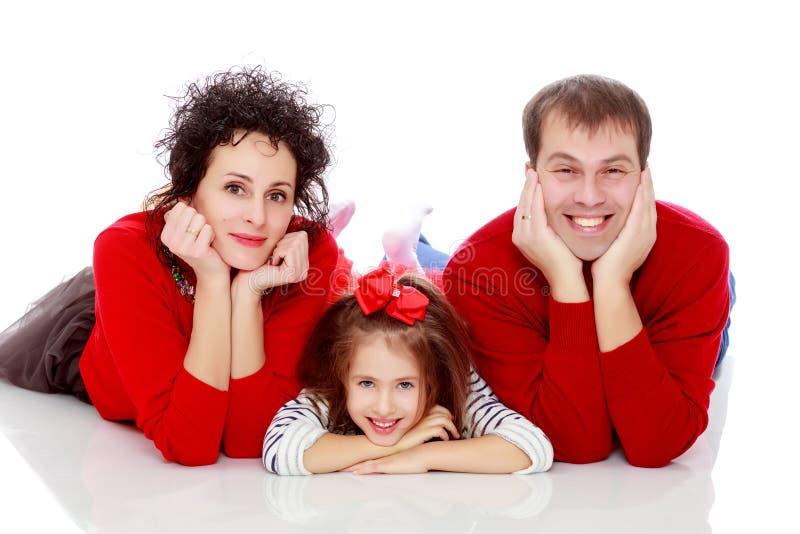 愉快的父母和年轻女儿 免版税库存照片