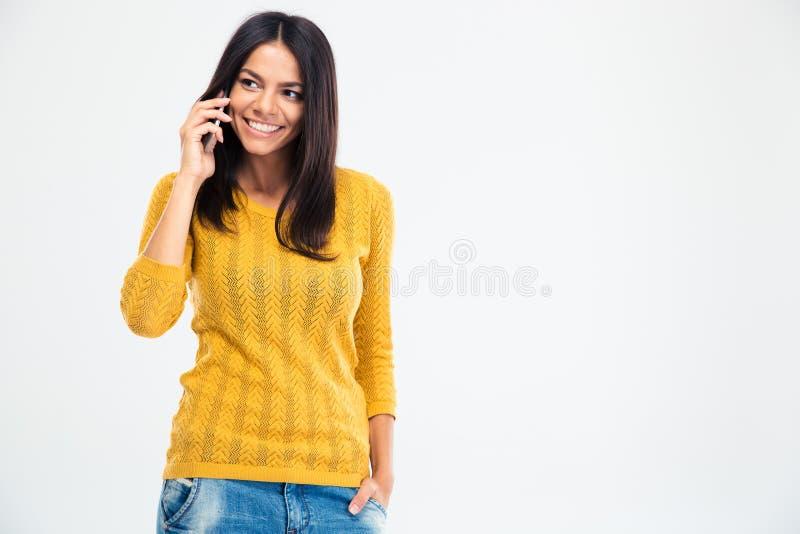 愉快的电话联系的妇女 免版税库存照片