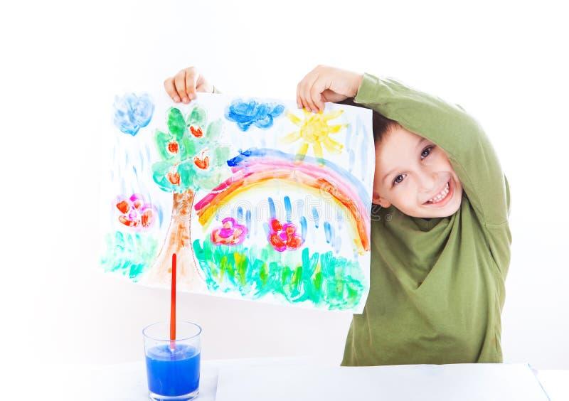 愉快的男孩提出绘画 免版税库存照片