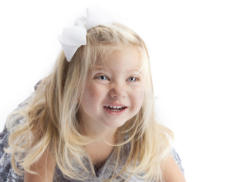 愉快的白肤金发的女孩白色背景 免版税库存照片