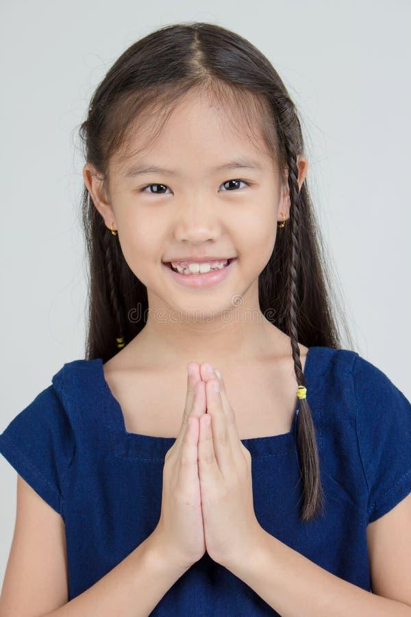 愉快的矮小的亚裔孩子画象  库存照片