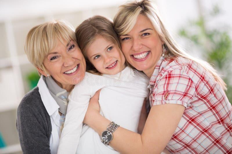 愉快的祖母、母亲和女儿 免版税库存图片