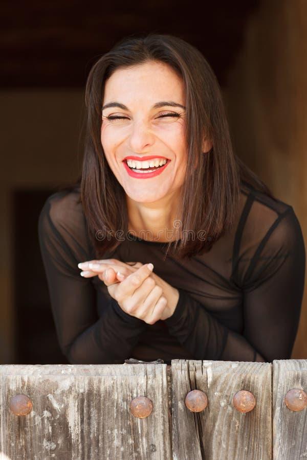 愉快的笑的妇女 图库摄影