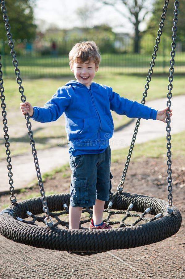 愉快的笑的男孩在公园 库存图片