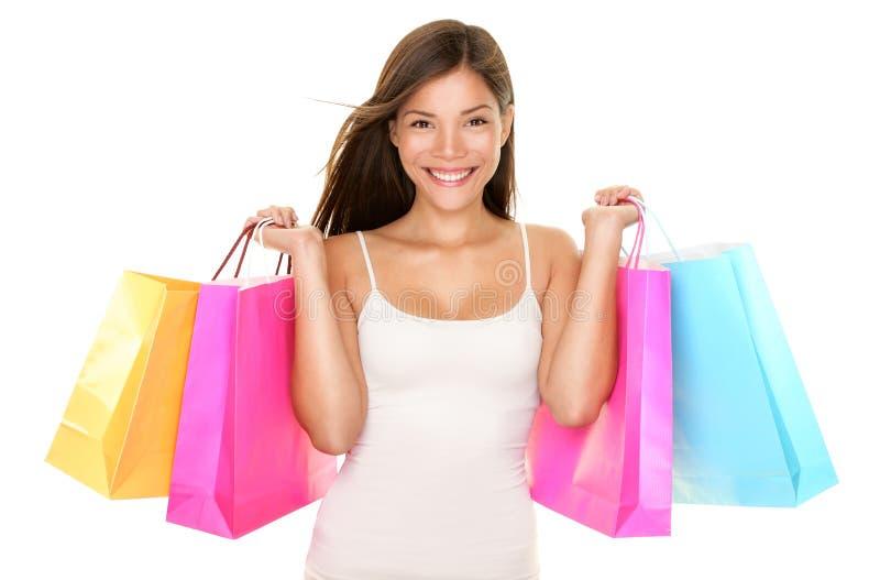 愉快的购物妇女 免版税库存照片