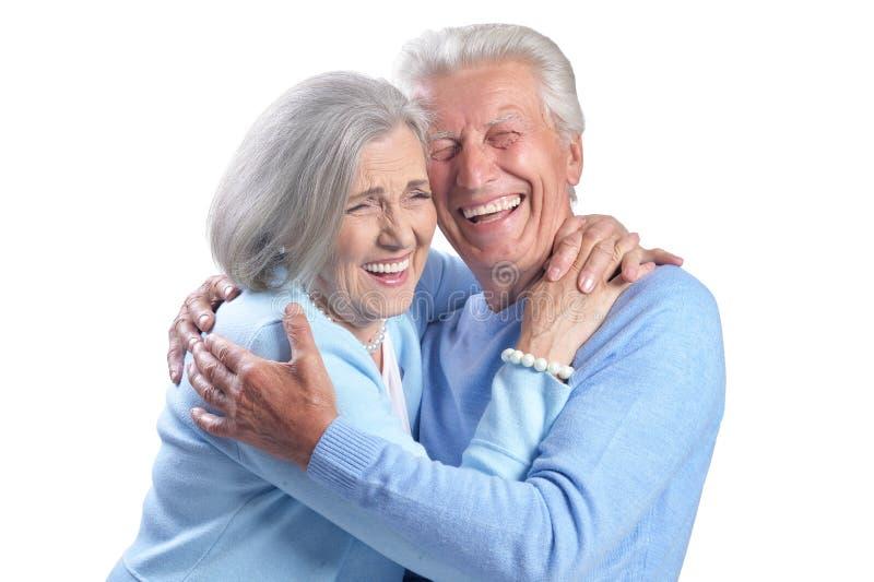 愉快的资深夫妇画象在白色背景的 免版税库存图片