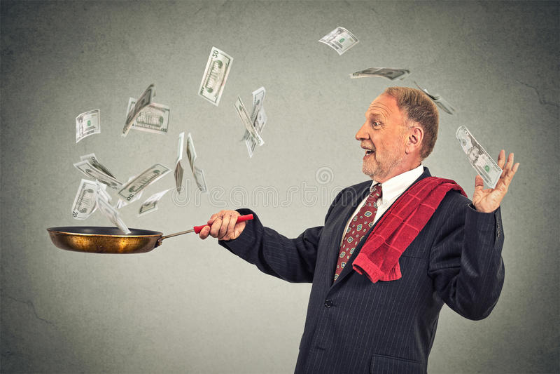 愉快的资深年长商人玩杂耍的金钱美金 免版税库存图片