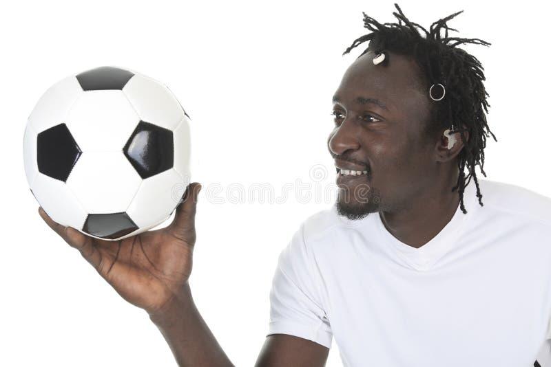 愉快的足球运动员画象  库存图片