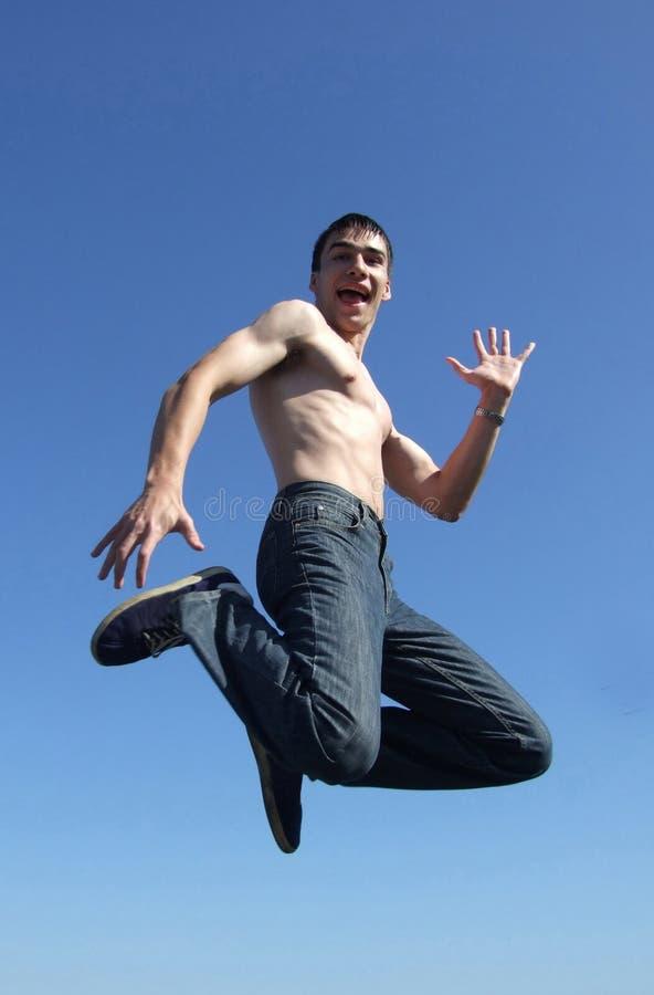 愉快的跳的人 免版税库存照片