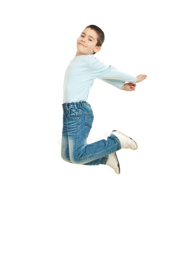 愉快的跳的孩子 库存照片